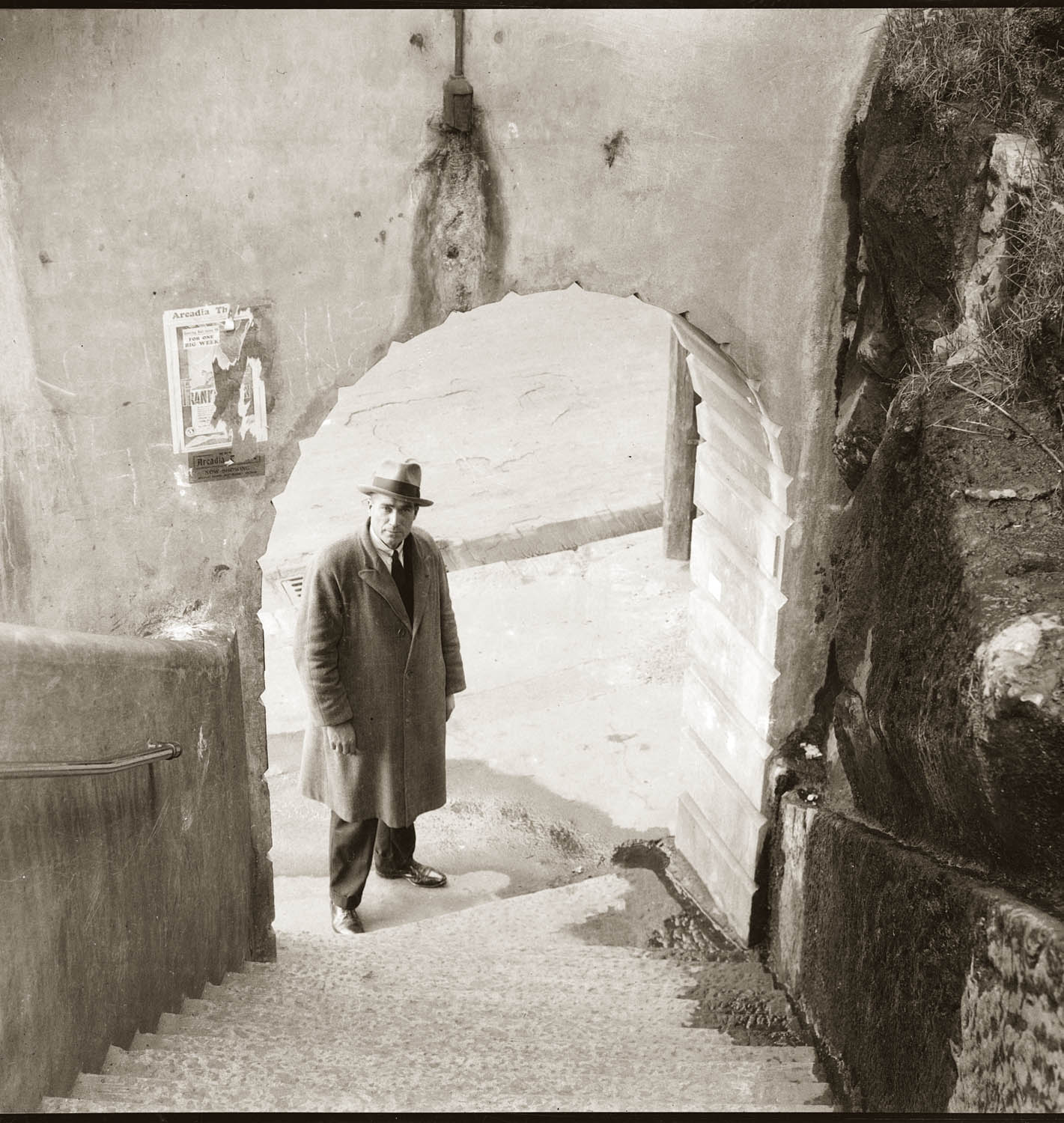 Detective at foot of Argyle Steps, The Rocks (Sydney), late 1930s. Details unknown.