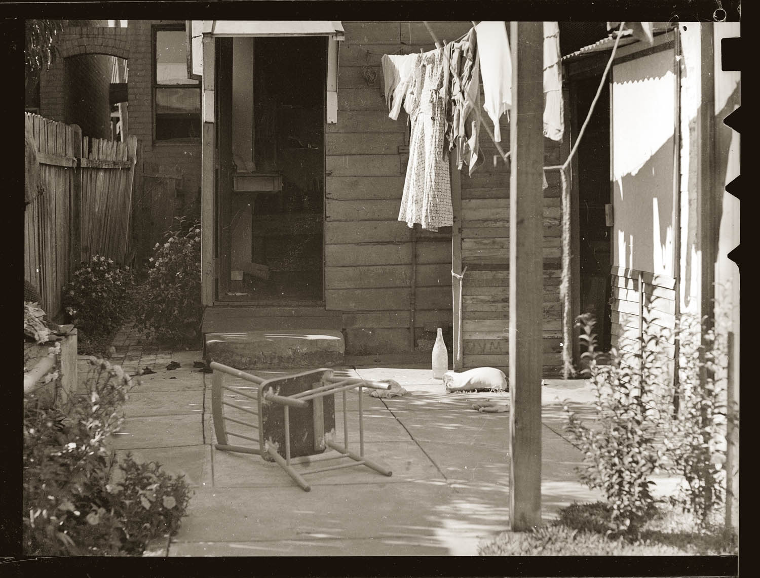 Backyard, washing line, overturned chair. Scene of attempted suicide, North Sydney 1948.