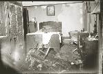 Fire-damaged bedroom, location, date unknown, presumably 1940s