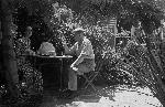 Sylvia and Alan Evans drinking tea in the back garden at Alwyn, Arncliffe, 25 December 1940 / Alan Evans