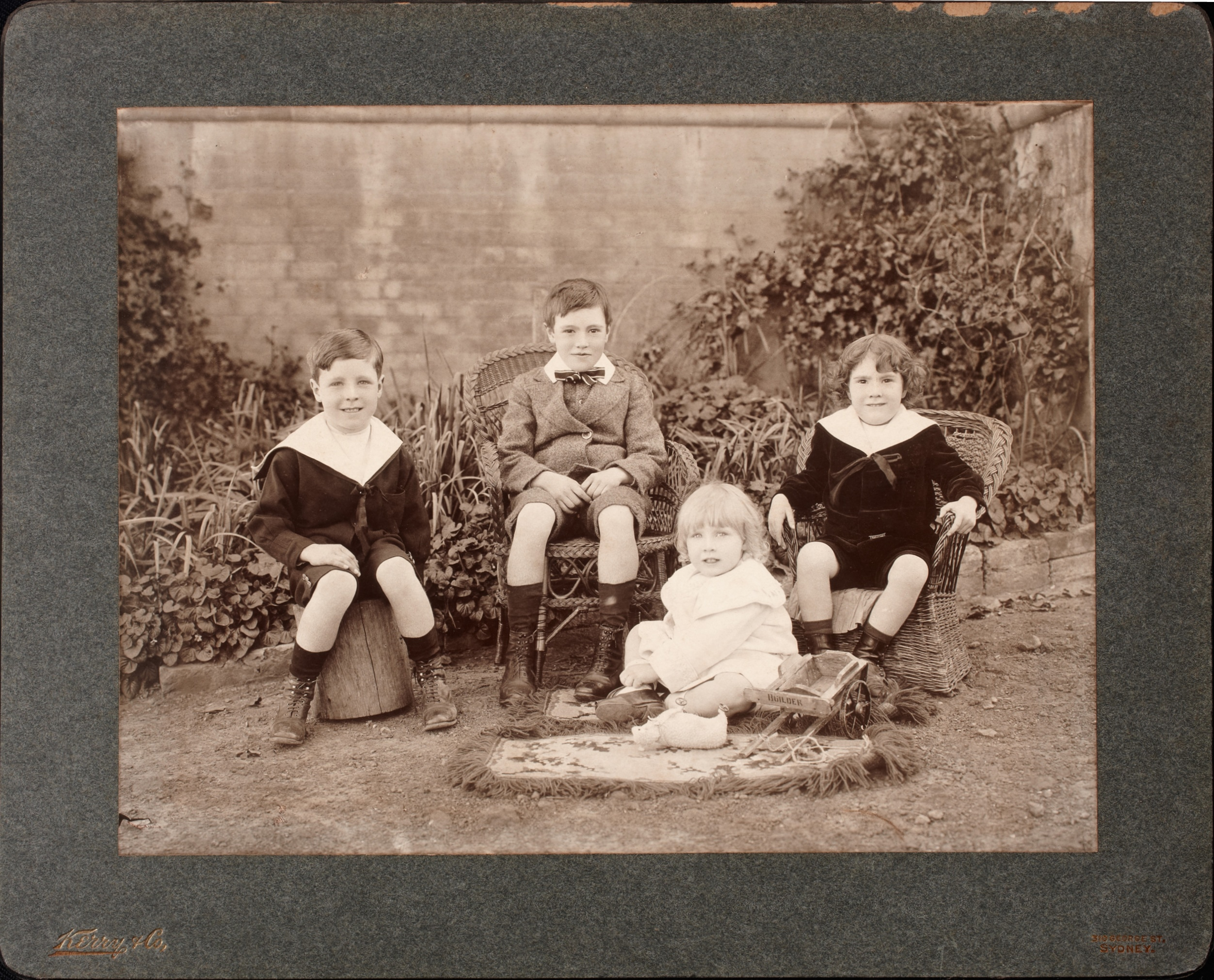 Studio photograph of the Terry brothers - Rod, Geoff, Gerald and Ted - children of George and Nina Terry, taken around 1907 / Kerry & Co.